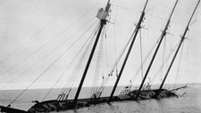 Photograph of the four-masted motor vessel, ARCTIC, crushed in an ice pack five miles south of Barrow, Alaska (1924)