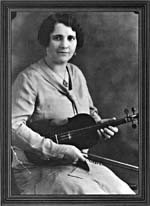 Photograph of Mary Bolduc, seated, with fiddle