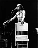 Photograph of Gilles Vigneault on stage