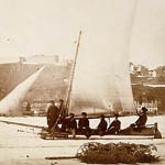 Photograph of six men on a an ice boat, a sailboat equipped with sled runners, Québec, circa 1858-1860